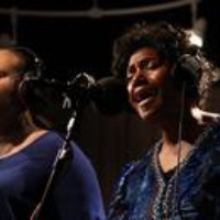 Logo du podcast Naomi Shelton And The Gospel Queens: Fiery Spirit In A 'Cold World' (Archives)