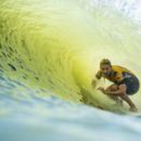Logo du podcast Kelly Slater's Perfect Wave Brings Surfing to a Crossroads