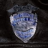 Cover of the album The Prodigy: Their Law the Singles 1990 - 2005